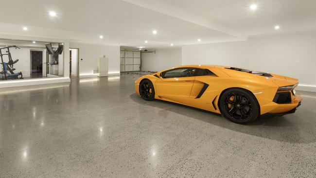 The basement not only fits four vehicles but there is also a gym, cellar, wet bar and cinema.