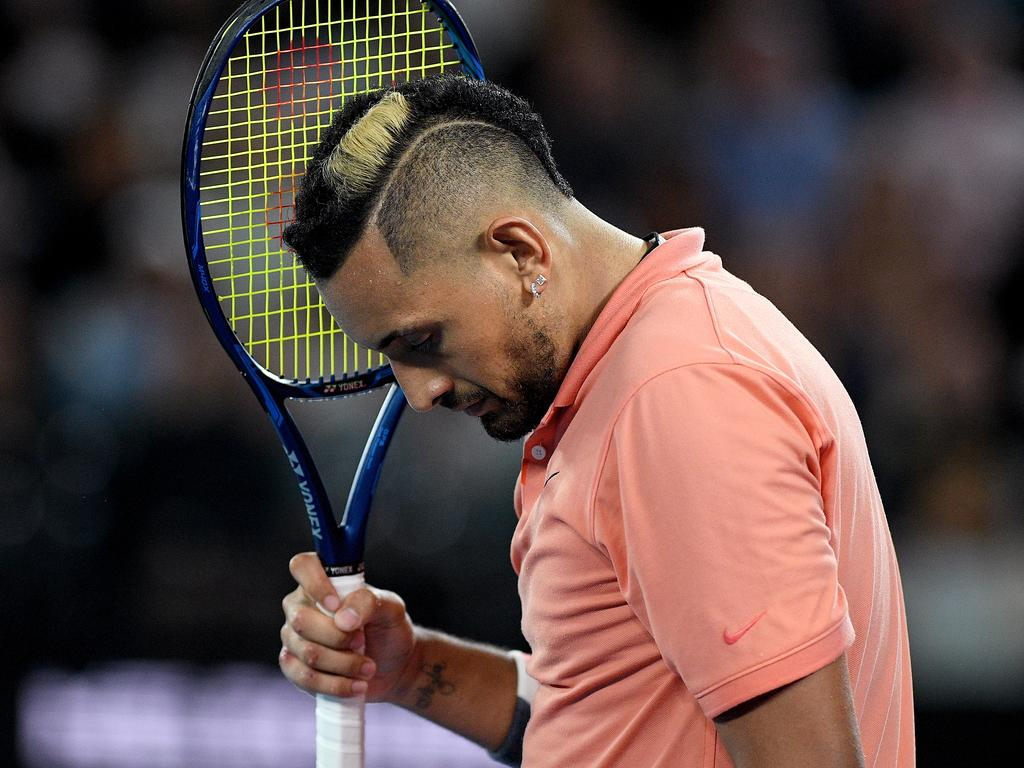 Nick Kyrgios of Australia reacts after losing his fourth round match against Rafael Nadal of Spain on day eight of the Australian Open tennis tournament at Rod Laver Arena in Melbourne, Monday, January 27, 2020. (AAP Image/Lukas Coch) NO ARCHIVING, EDITORIAL USE ONLY