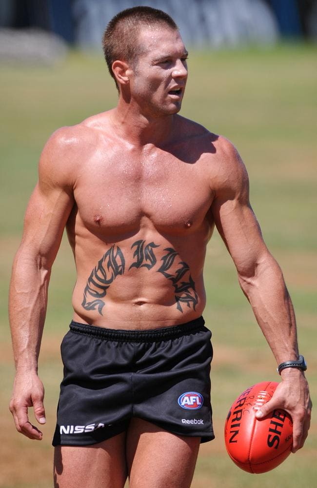 Ben Cousins (with tattoo) during his time at Richmond.