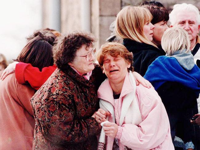 Distressed relatives near Dunblane Primary School after gunman Thomas Hamilton burst into a gym class and killed 16 students and their teacher before turning a gun on himself.