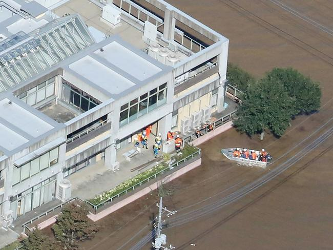 This aerial view shows rescue workers moving residents from the flooded Kawagoe Kings Garden nursing home. Picture: AFP/Japan OUT