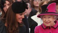 Catherine, The Duchess of Cambridge (L) and Queen Elizabeth II watch a fashion show at De Montfort University in Leicester, 08/03/2012.