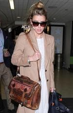 Amber Heard was spotted flying solo on the May 18, 2016 at LAX. Picture: Splash News Australia