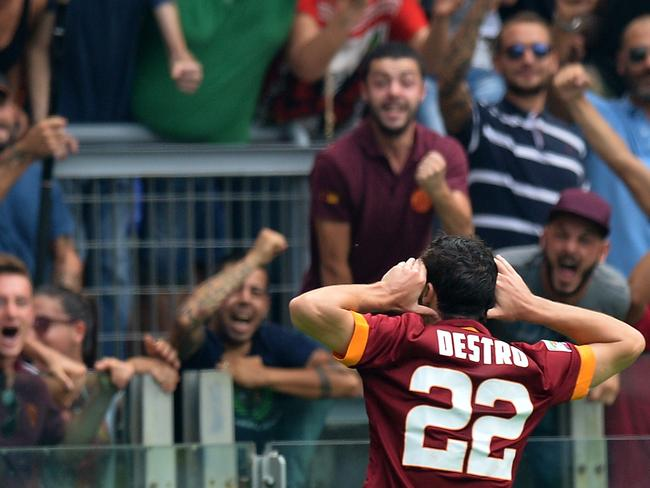 Mattia Destro celebrates his impressive strike.