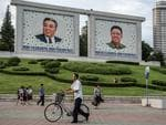 People walk past pictures of Kim Il-sung and Kim Jong-il on August 18, 2018 in Pyongyang, North Korea. Picture: Carl Court/Getty Images