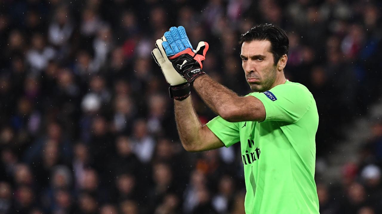 Paris Saint-Germain's Italian goalkeeper Gianluigi Buffon applauds the crowd after the game