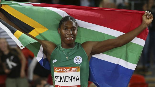 Caster Semenya with the South African flag after winning the 1500m.