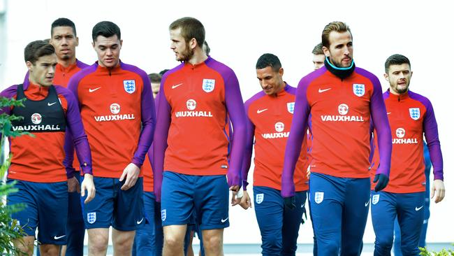 Kane, (R), Eric Dier, (C) and Harry Winks (L) walk during a national football team training session.