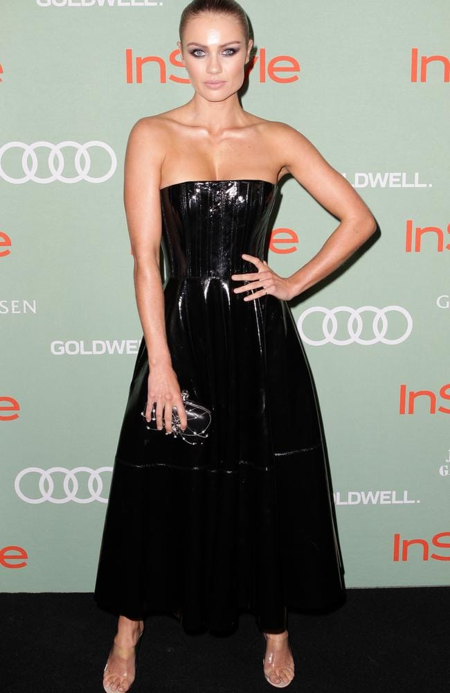 Model Elyse Knowles wore a dramatic Alex Perry dress with Yeezy heels and slicked-back hair. Picture: Christian Gilles