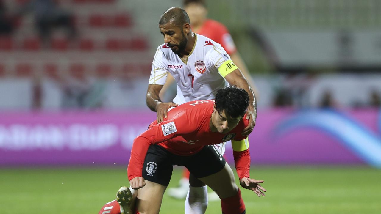 South Korea's forward Son Heung-Min, front, and Bahrain's midfielder Ali Al Safi fight for the ball in their Asian Cup meet.