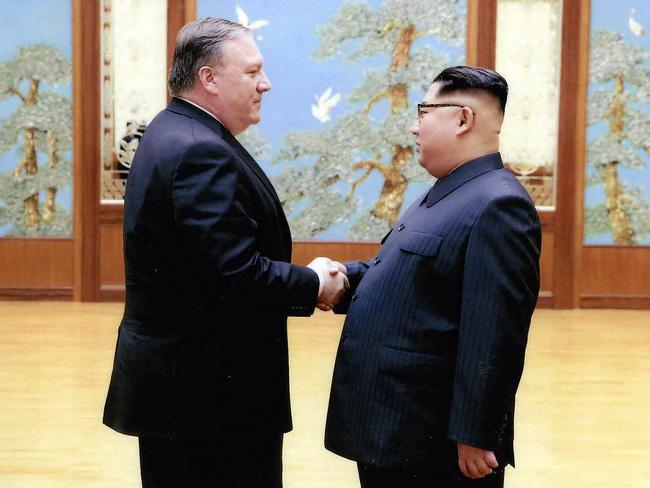 In this image released by the White House, then-CIA director Mike Pompeo shakes hands with North Korean leader Kim Jong-un in Pyongyang, during a 2018 trip. Picture: AP