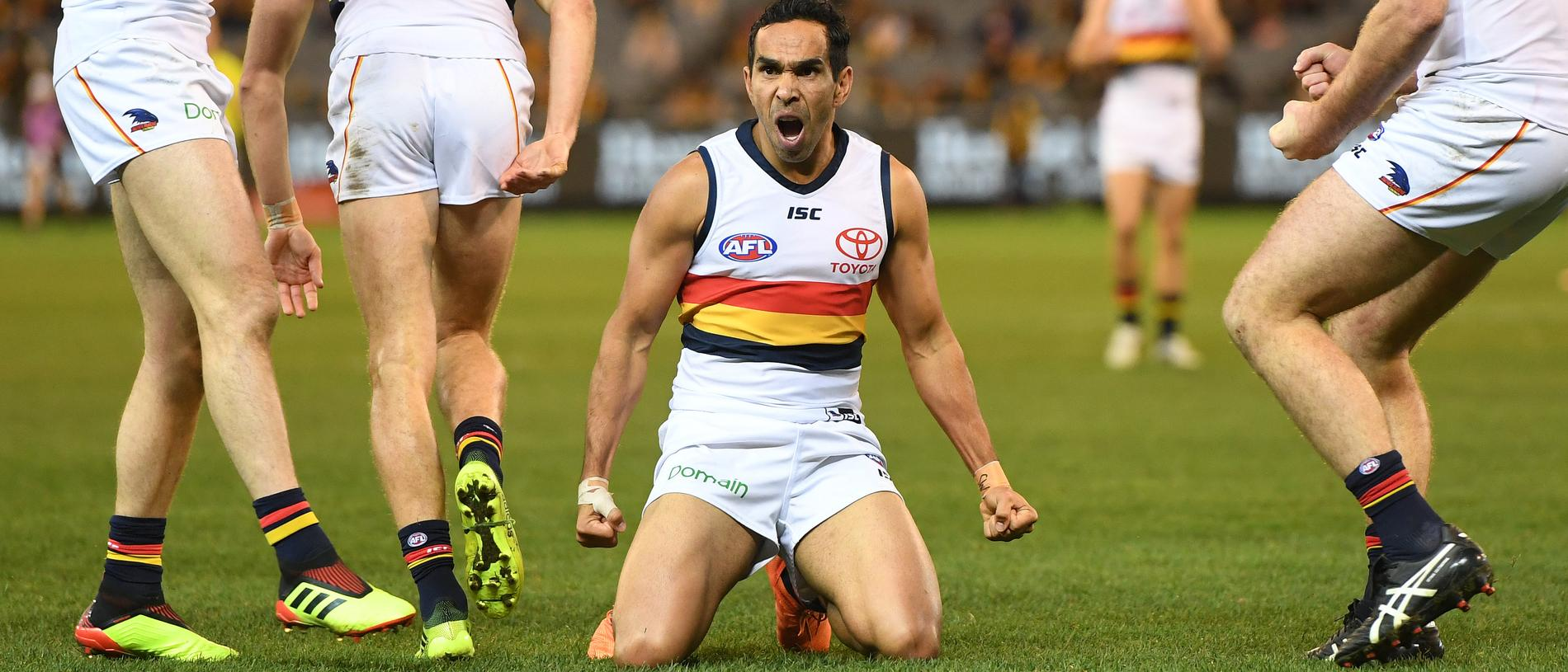 Eddie Betts of the Crows (third from left) reacts after kicking a goal during the Round 13 AFL match between the Hawthorn Hawks and the Adelaide Crows at the MCG in Melbourne, Saturday, June 16, 2018. (AAP Image/Julian Smith) NO ARCHIVING, EDITORIAL USE ONLY