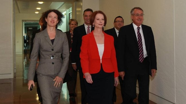 The Prime Minister Julia Gillard with Wayne Swan and other MPs as they entered the caucus room for the leadership ballot. Picture: Gary Ramage