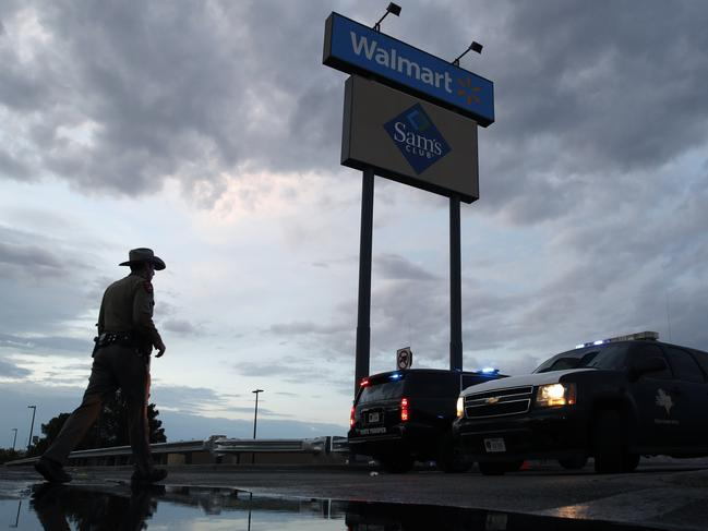 Law enforcement officials block a road at the scene of a mass shooting at a shopping complex Sunday, Aug. 4, 2019, in El Paso, Texas. Picture: AP
