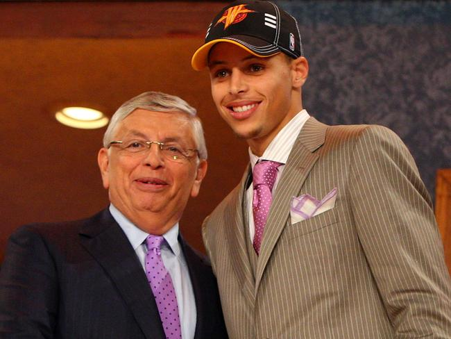 David Stern with Stephen Curry at the 2009 NBA Draft. (Photo by Jim McIsaac/Getty Images)