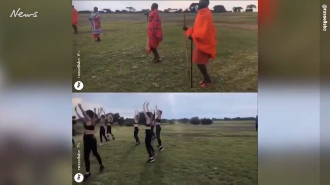 Maasai people used as props in fitness routine