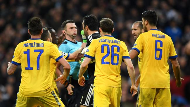 Gianluigi Buffon of Juventus confronts the referee