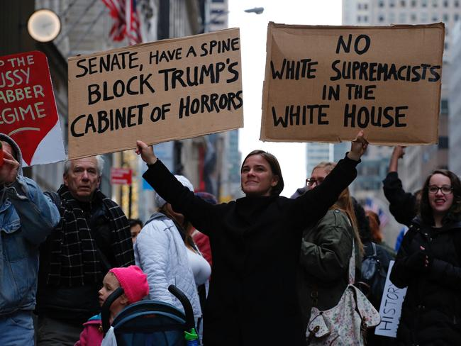 A woman protests against US President-elect Donald Trump in front of Trump Tower. Picture: AFP / Kena Betancur