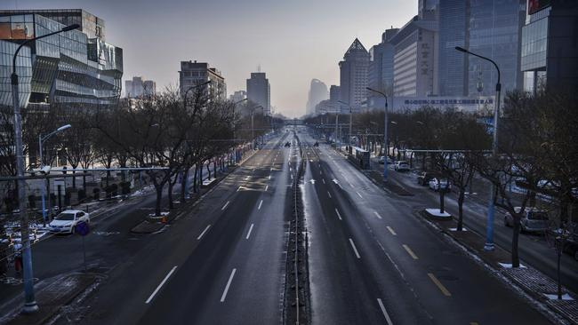 A nearly empty street is seen in a usually busy shopping district on February 9, 2020 in Beijing, China. Picture: Kevin Frayer/Getty Images