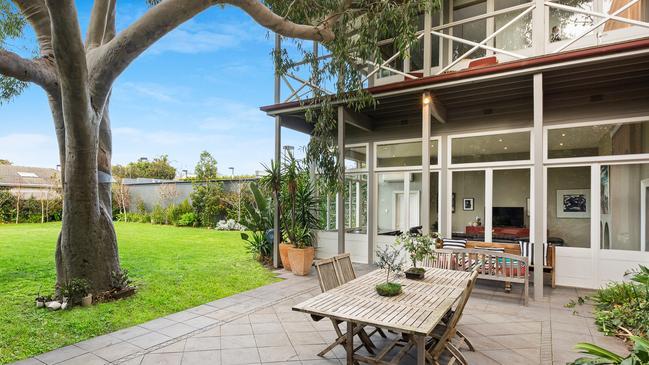 The alfresco deck and big backyard.