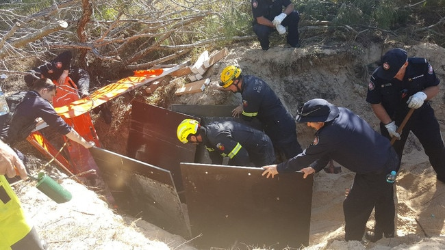 Emergency services had to take extreme caution to remove the man from the sinkhole. Picture: Queensland Police Service
