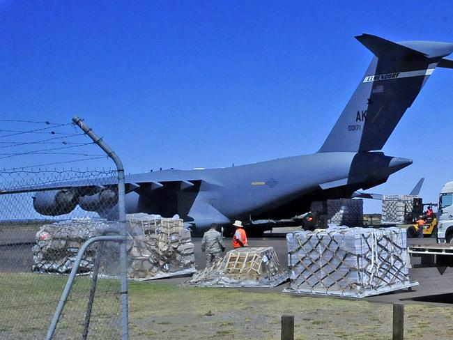 A US Air Force Plane is loaded with pallets of data collected from the Pine Gap Defence Facility at Alice Springs Airport.