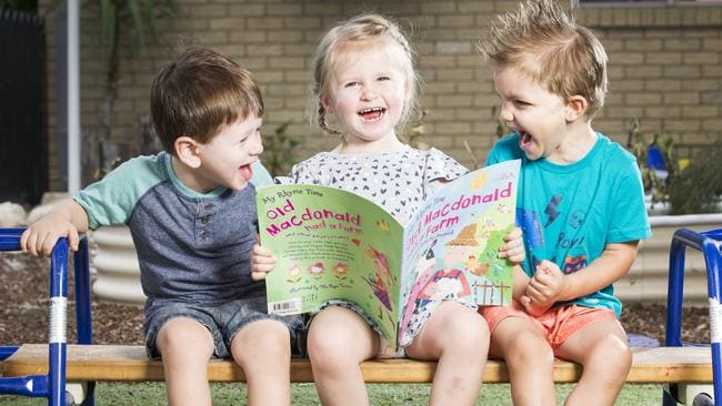 Charlie, Molly and Jackson reading Old McDonald. Picture: Lachie Millard