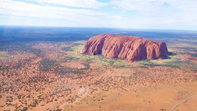 The local Aboriginal people ask people not to climb Uluru. Picture: Kimberley Caines/Ayers Rock Helicopters.