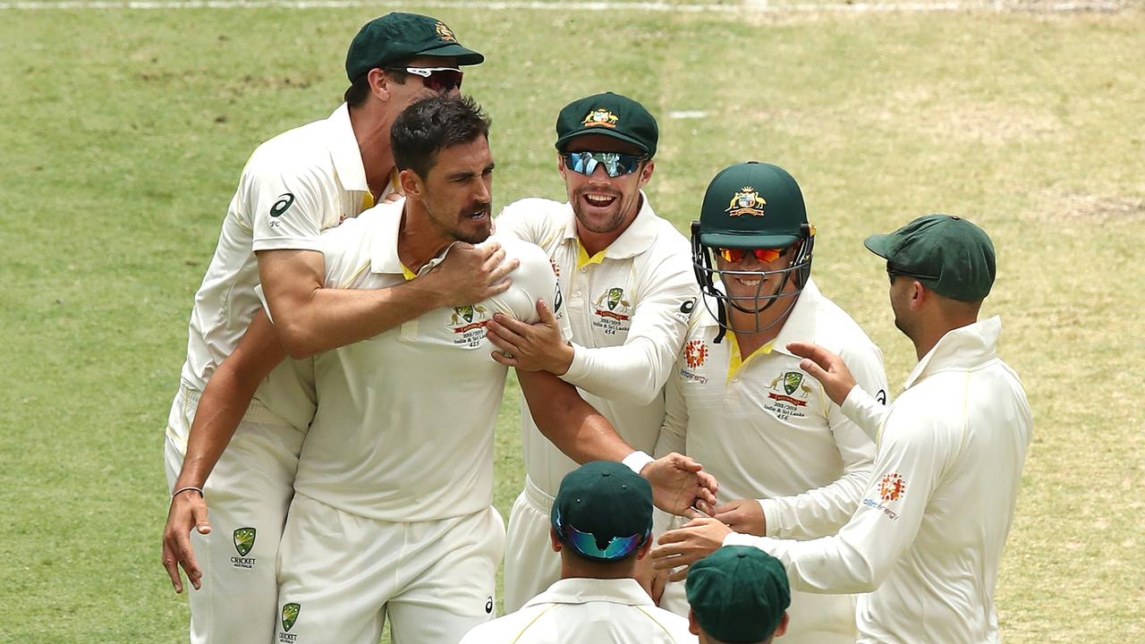 Mitchell Starc fired up after claiming the wicket of Murali Vijay. Photo: Ryan Pierse/Getty Images.
