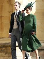 Pippa Matthews and husband James Matthews arrive to attend the wedding of Princess Eugenie of York and Jack Brooksbank at St George's Chapel, Windsor Castle, near London, England, Friday Oct. 12, 2018. (Adrian Dennis/Pool via AP)