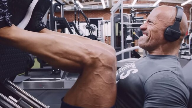 The former wrestler's strength and conditioning coach of seven years Dave Rienzi described him as being in the best shape of his life. Here he's doing an unilateral press. Picture: YouTube/ The Rock