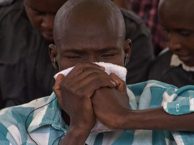Tragedy ... A man holds a cloth to his face as he waits to view the body of a relative killed in Thursday's attack on Kenya's Garissa university. Al-Shabab gunmen rampaged through a university in north-eastern Kenya at dawn Thursday, killing almost 150 people. Photo: Sayyid Azim