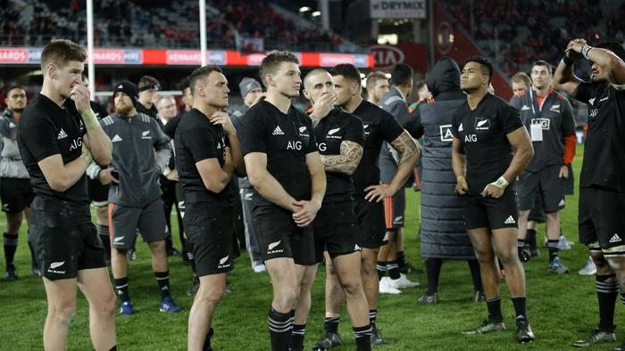 All Blacks players watch the trophy presentation ceremony following the third Test.