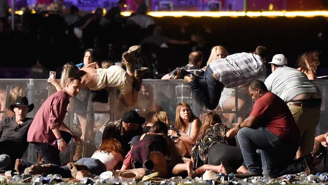 People scramble for shelter as gunfire continues at the Route 91 Harvest country music festival in Las Vegas is the worst mass murder in US history. Picture: David Becker/Getty Images/AFP