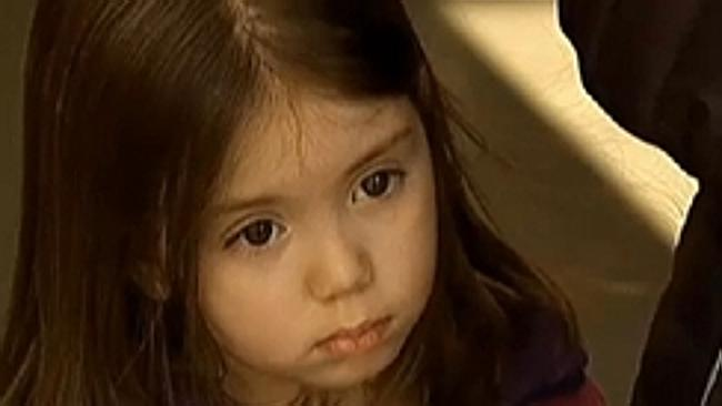 Little Kaelyn Kerr after being rescued from a broken lift by firefighters who sang 'Let it Go' to calm the four-year-old down so she could climb a ladder to safety.