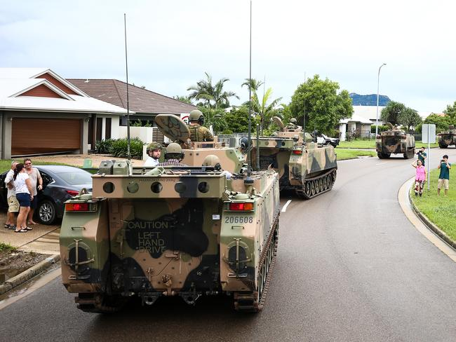 A convoy of armoured vehicles driving through Townsville yesterday. Picture: Dave Acree