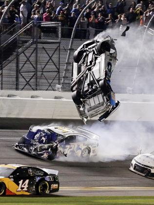 Newman's car flips through the air after hitting LaJoie.