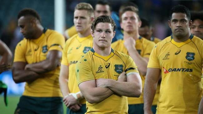 Michael Hooper of Australia stands with his team mates.