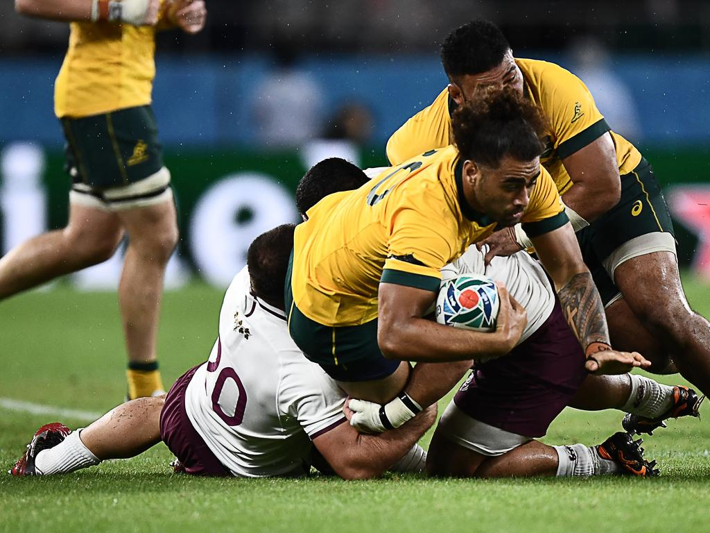 Australia's back row Lukhan Salakaia-Loto (C) is tackled  during the Japan 2019 Rugby World Cup Pool D match between Australia and Georgia at the Shizuoka Stadium Ecopa in Shizuoka on October 11, 2019. (Photo by Anne-Christine POUJOULAT / AFP)
