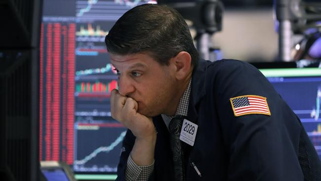Trader Michael Gallucci works at his post on the floor of the New York Stock Exchange, Wednesday, March 11, 2020. Picture: AP /Richard Drew.