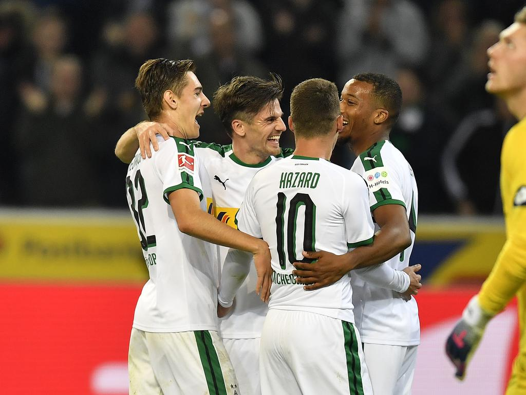 Moenchengladbach's Jonas Hofmann, 2nd from left, celebrates with teammates his third goal during the German Bundesliga soccer match between Borussia Moenchengladbach and FSV Mainz 05 in Moenchengladbach, Germany, Sunday, Oct. 21, 2018. (AP Photo/Martin Meissner)