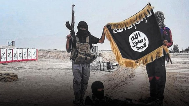 Militants of Islamic State posing with the trademark jihadists flag.