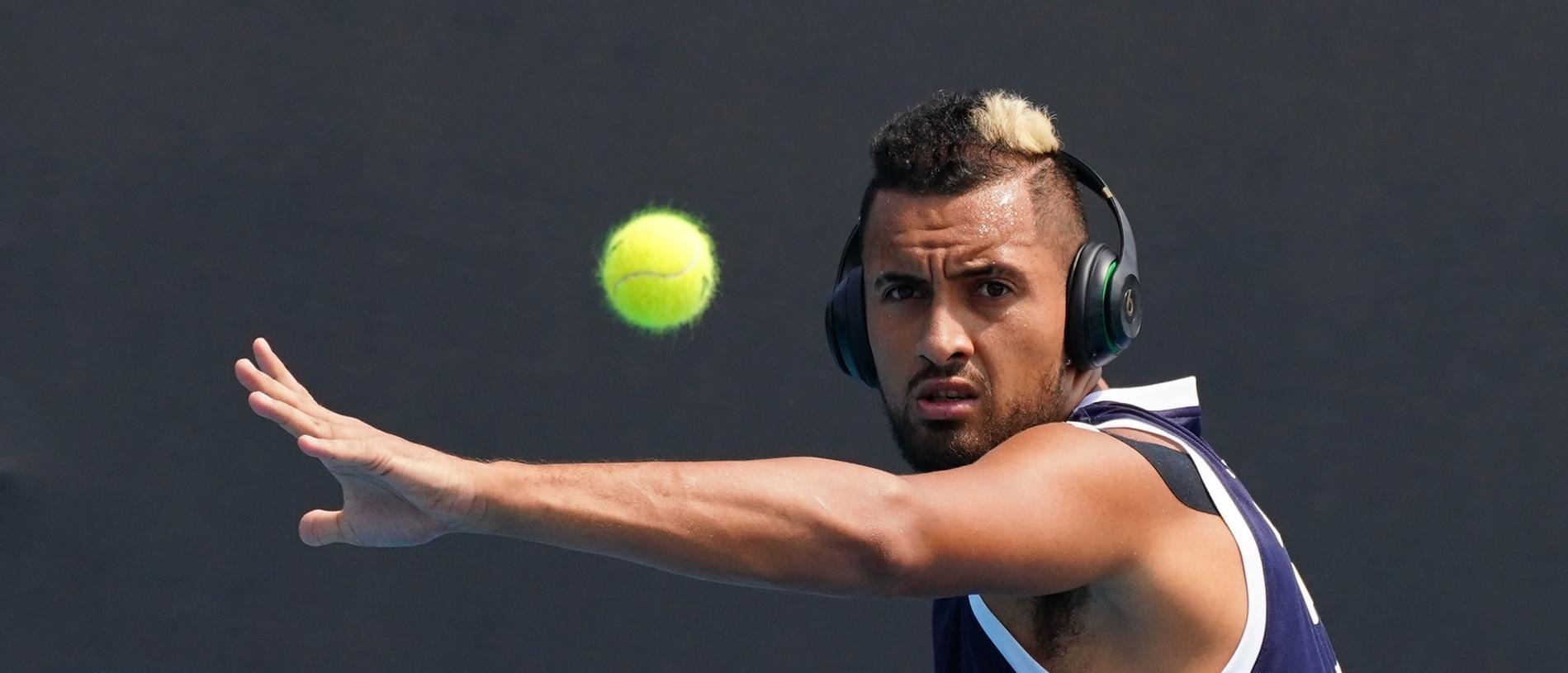 Nick Kyrgios of Australia plays a shot during an Australian Open practice session at Melbourne Park in Melbourne, Saturday, January 18, 2020. (AAP Image/Scott Barbour) NO ARCHIVING