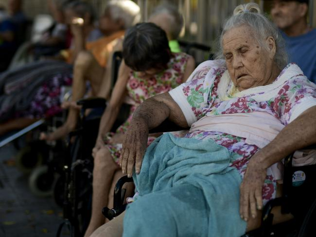 Seniors who live at a nursing home sit outside their residence after they were evacuated due to an earthquake in Ponce, Puerto Rico. Picture: AP