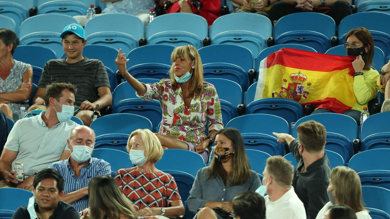 A spectator gestures during the men's singles match between Spain's Rafael Nadal and Michael Mmoh (Photo by Brandon MALONE / AFP)