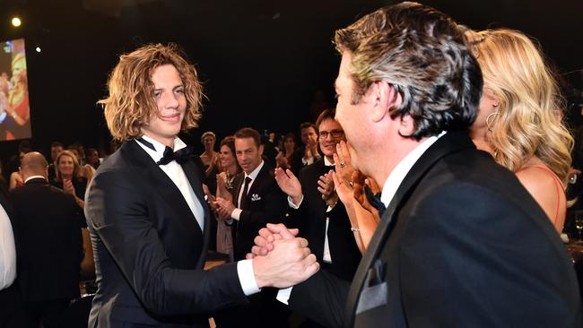 Fremantle Dockers player Nathan Fyfe and club CEO Steve Rosich reacts after winning the Brownlow Medal.