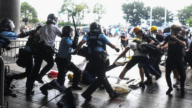 Protesters were pushed out. Picture: Anthony Wallace/AFP