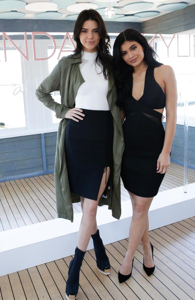 Signature pose ... Kendall and Kylie, wearing Forever New, in Sydney this week. Picture: Lucas Dawson