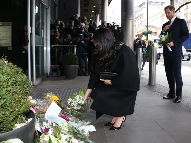 The Duke and Duchess of Sussex add bouquets of flowers to a pile of floral tributes at the New Zealand High Commission in London. Picture: AFP