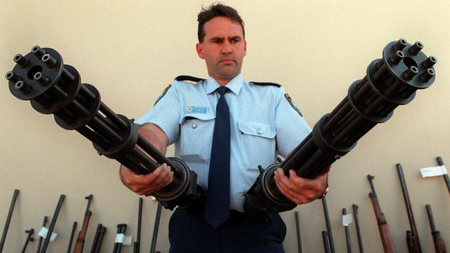 A police officer with some of the guns surrendered in 1997 as part of the buyback scheme.
